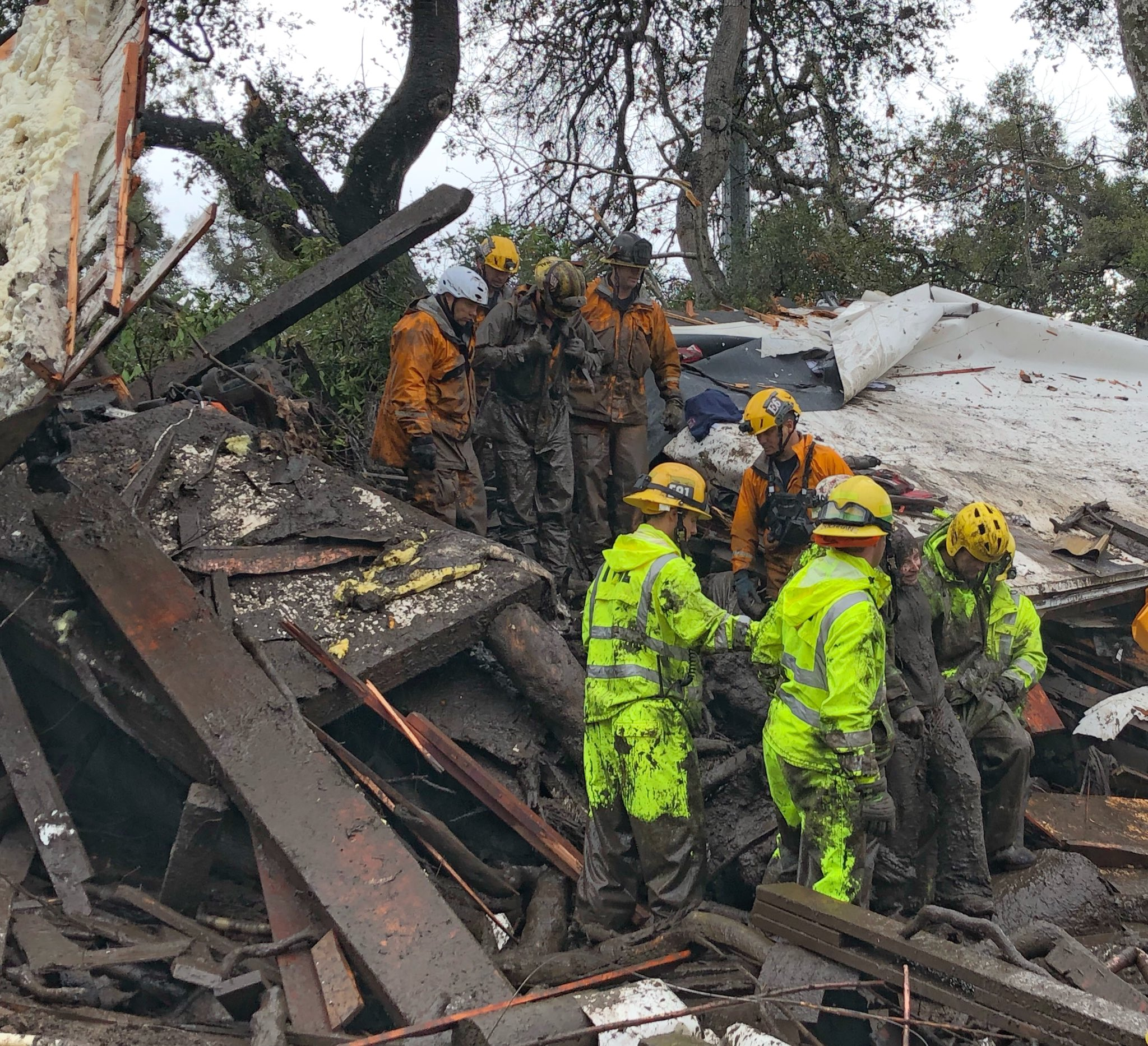 Firefighters successfully rescued a 14 yr old girl (right) after she was trapped for hours inside a destroyed home in Montecito. (Photo: Mike Eliason / Santa Barbara County Fire)