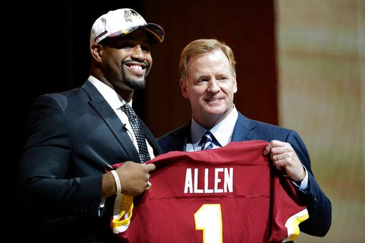Alabama's Jonathan Allen, left, poses with NFL commissioner Roger Goodell after being selected by the Washington Redskins in the first round at pick no. 17 in the 2017 NFL football draft, Thursday, April 27, 2017, in Philadelphia. (AP File Photo/Julio Cortez)