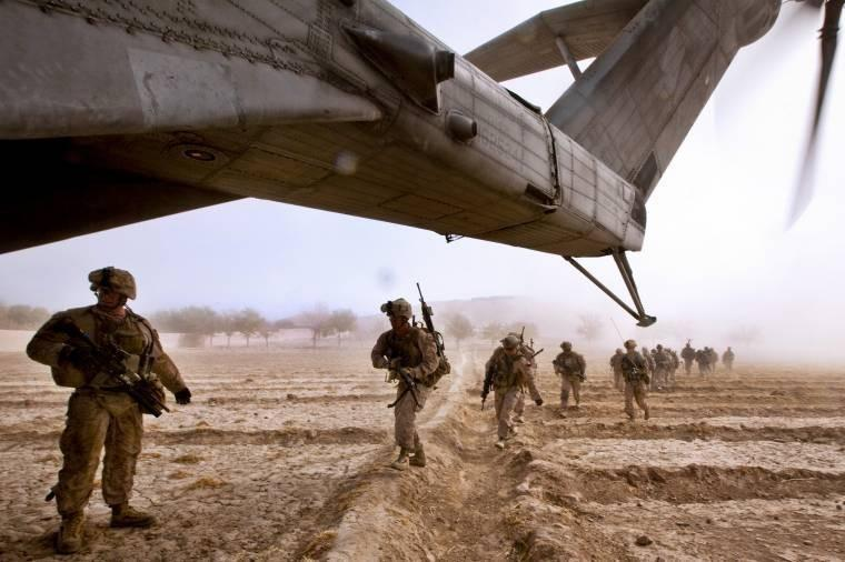 U.S. Marines run toward a CH-53E Super Stallion helicopter after an interdiction operation at Gurjat village in Afghanistan's Helmand province, Oct. 28, 2013.
