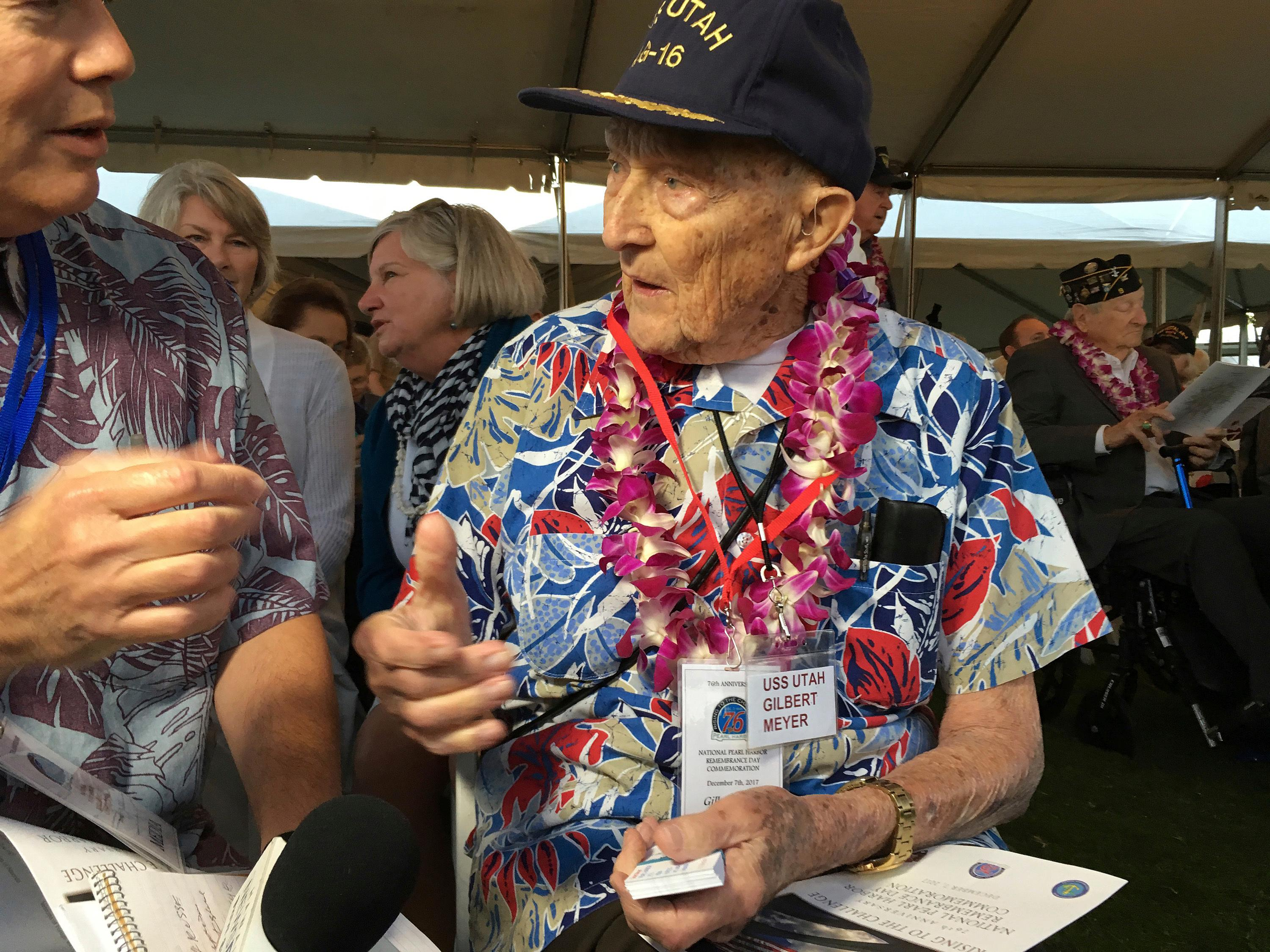 Pearl Harbor survivor Gilbert Meyer, 95, who lives near Lytle, Texas, speaks to a reporter before a remembrance ceremony at Pearl Harbor, Hi., on Thursday, Dec. 7, 2017. (AP Photo/Audrey McAvoy)