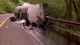 Rolled semi trailer spills tar-like substance, SR-14 closed east of Washougal
