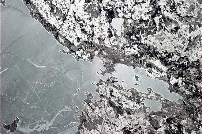 Orillia, Ontario, with the ice still a sheet on Lake Simcoe.  (Photo & Caption: Chris Hadfield/NASA)