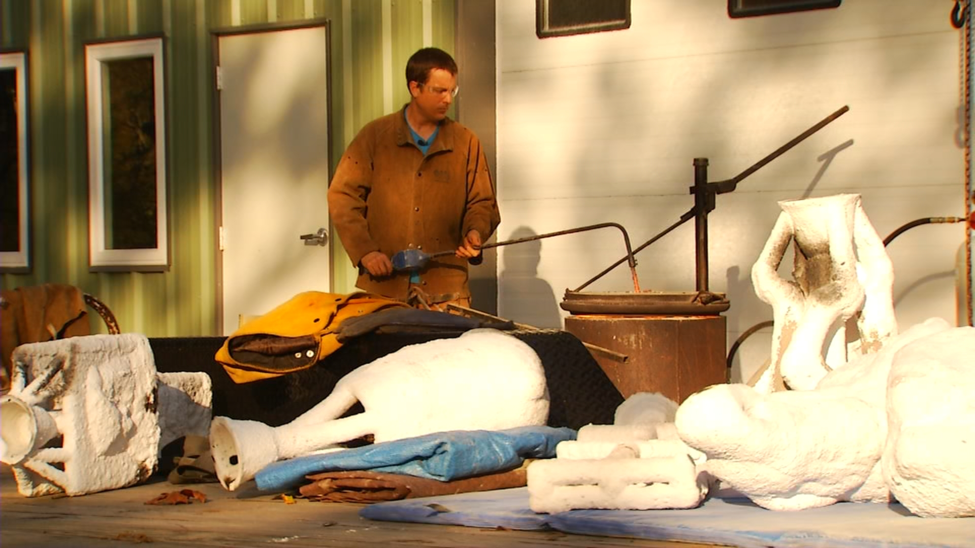 News13 filmed Frahm while he poured melted bronze into molds for a sculpture (Courtesy: WLOS)<p></p>
