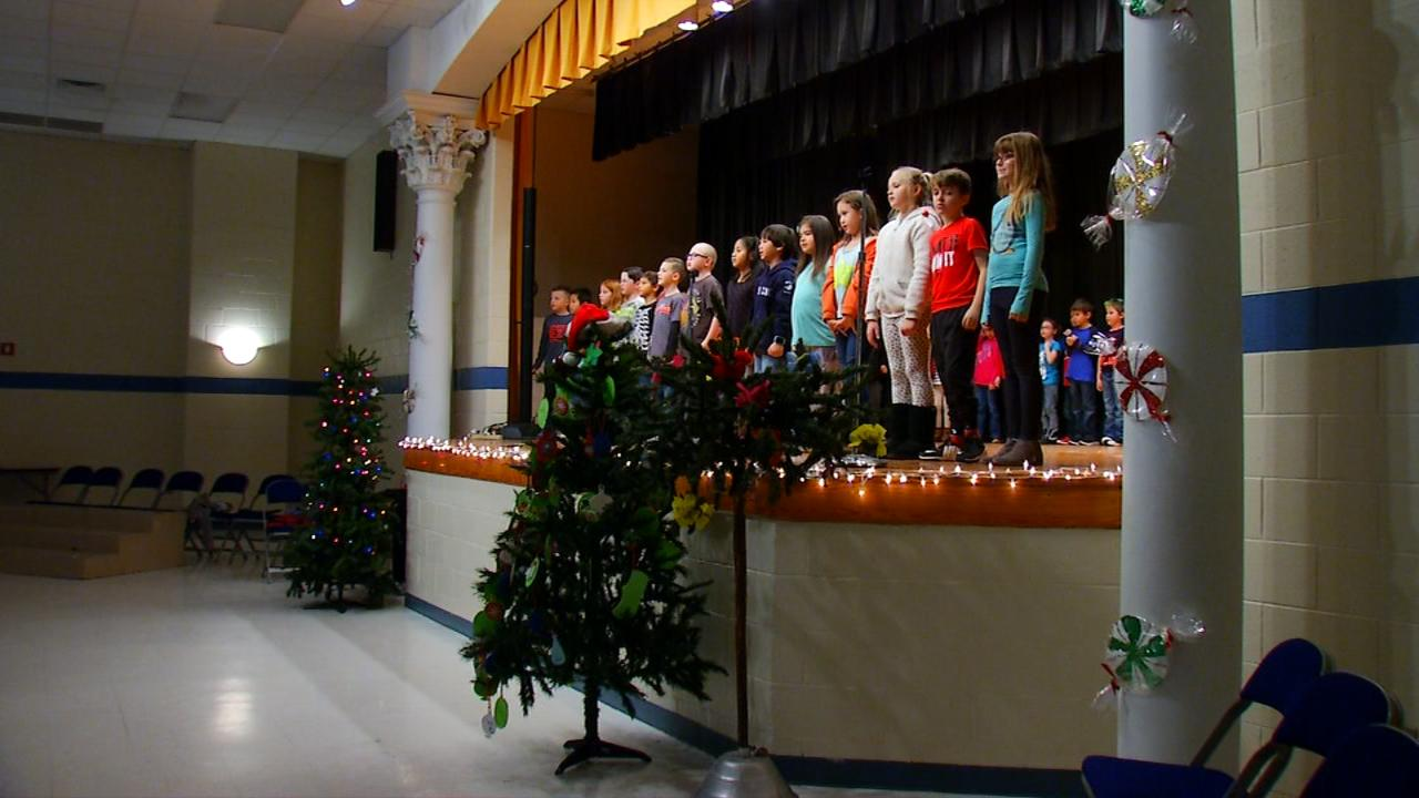 "Students at Pleasant Gardens Elementary perform their dress rehearsal for their ""Christmas Around the World"" program. (Photo credit: WLOS Staff)"
