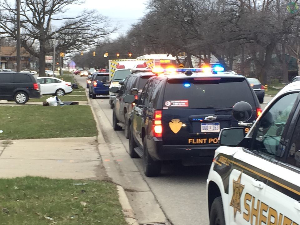A Flint mother put some of her children in a suitcase and set them out to the road as Child Protective Services came to take custody of them, according to Flint police. (Photo: WEYI/WSMH)