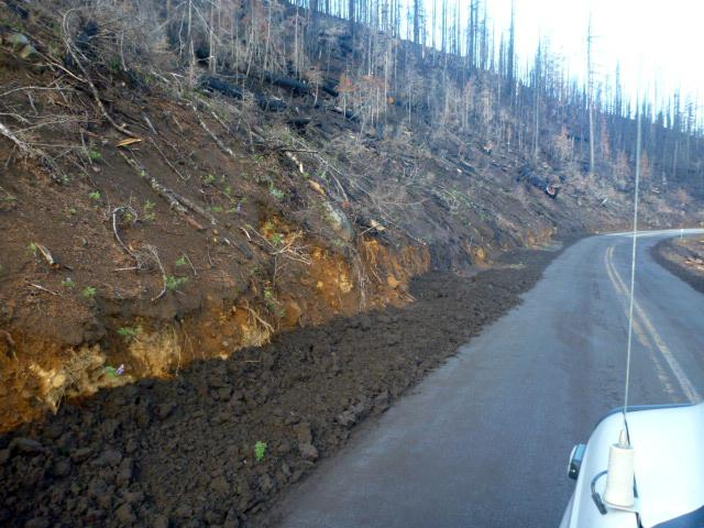 Rain from thunderstorms swept mud and debris across McKenzie Pass Highway 242 on Wednesday, forcing the Oregon DOT to close the scenic route just two days after it reopened to cars. Crews are working to clear the road Thursday (pictured). ODOT expects the road to reopen as soon as cleanup is complete. (ODOT)