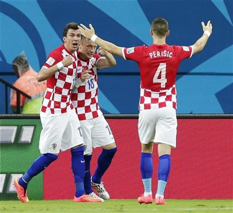Croatia's Ivica Olic (18) celebrates with his teammates after scoring his side's first goal during the group A World Cup soccer match between Cameroon and Croatia at the Arena da Amazonia in Manaus, Brazil, Wednesday, June 18, 2014.