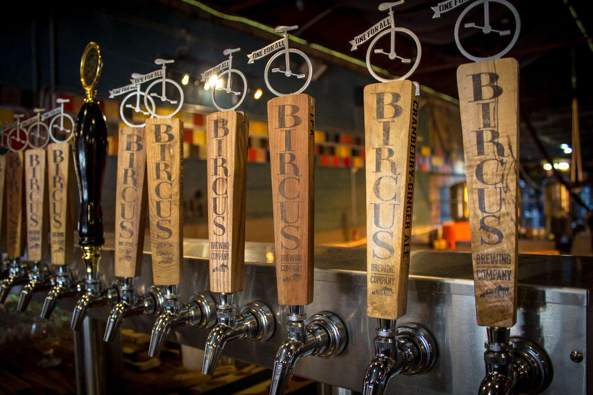 The grain accenting the beer tap handles are much like the flavors of beers dispensed at Bircus Brewing: no two are the same. / Image: Austin Coop // Published: 2.7.19