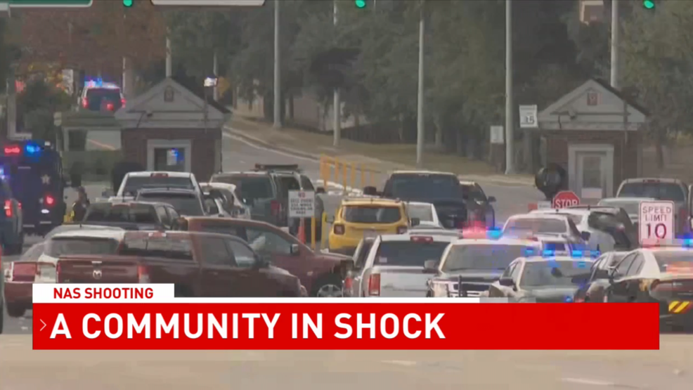 (Image: WPMI) People react to NAS shooting in Pensacola