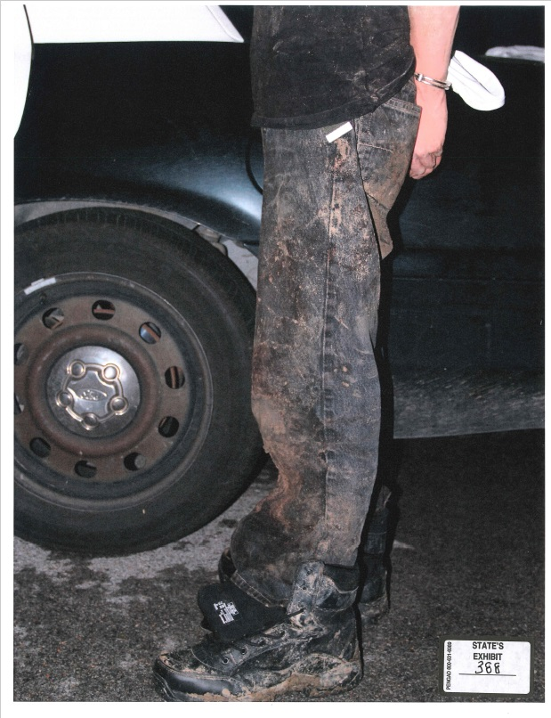 A photograph of Robert Bever's pants after his arrest for killing his parents and three siblings. (KTUL)
