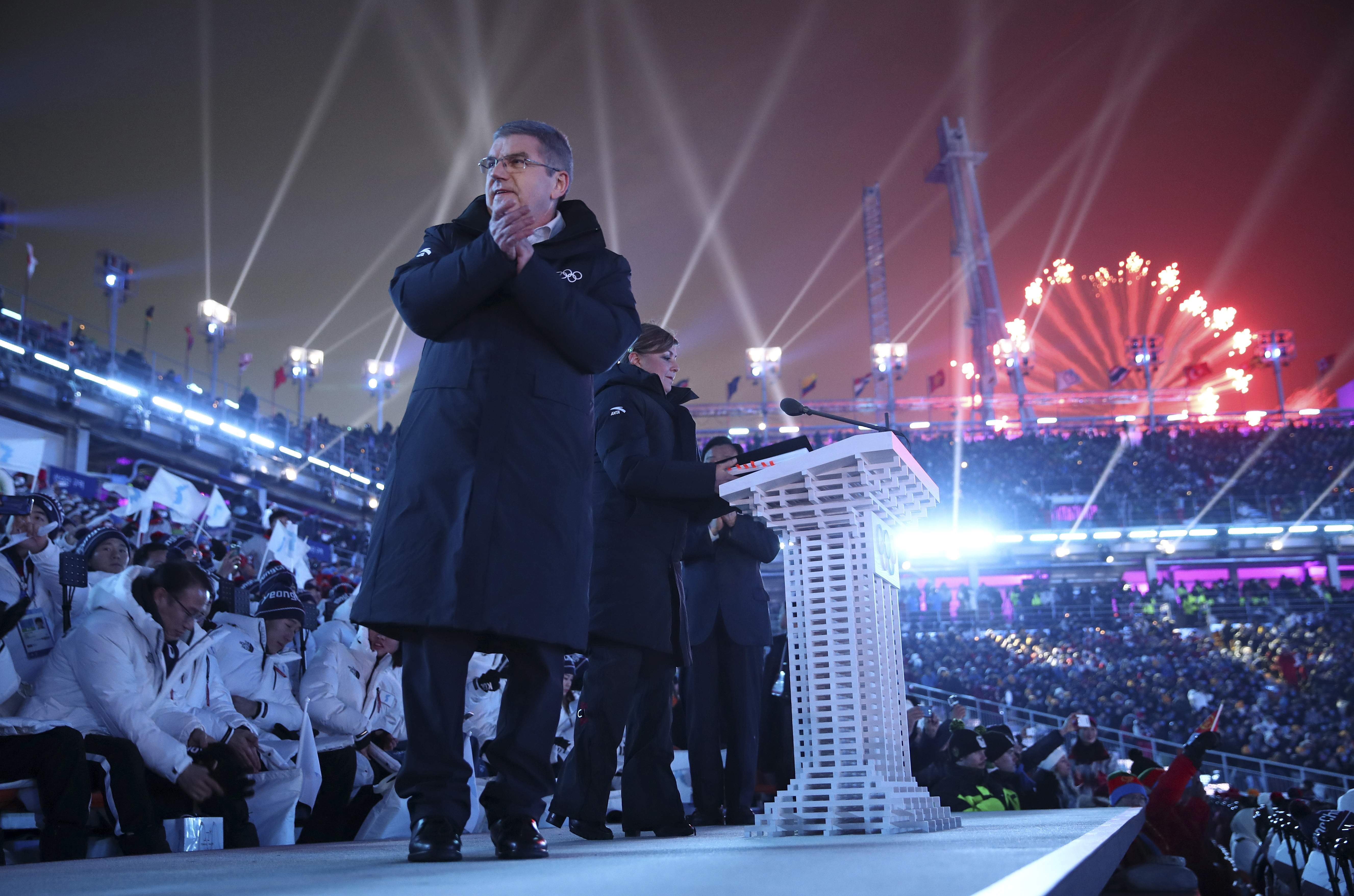 Thomas Bach, president of the International Olympic Committee, claps on stage during the opening ceremony of the 2018 Winter Olympics in Pyeongchang, South Korea, Friday, Feb. 9, 2018. (Clive Mason/Pool Photo via AP)