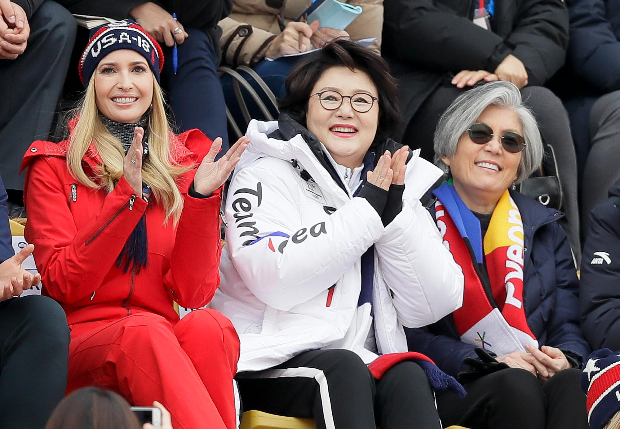 Ivanka Trump, left, sits with Kim Jung-sook, wife of the South Korean President and South Korean Foreign Minister Kang Kyung-wha, right, during the men's Big Air snowboard competition at the 2018 Winter Olympics in Pyeongchang, South Korea, Saturday, Feb. 24, 2018. (AP Photo/Kirsty Wigglesworth)