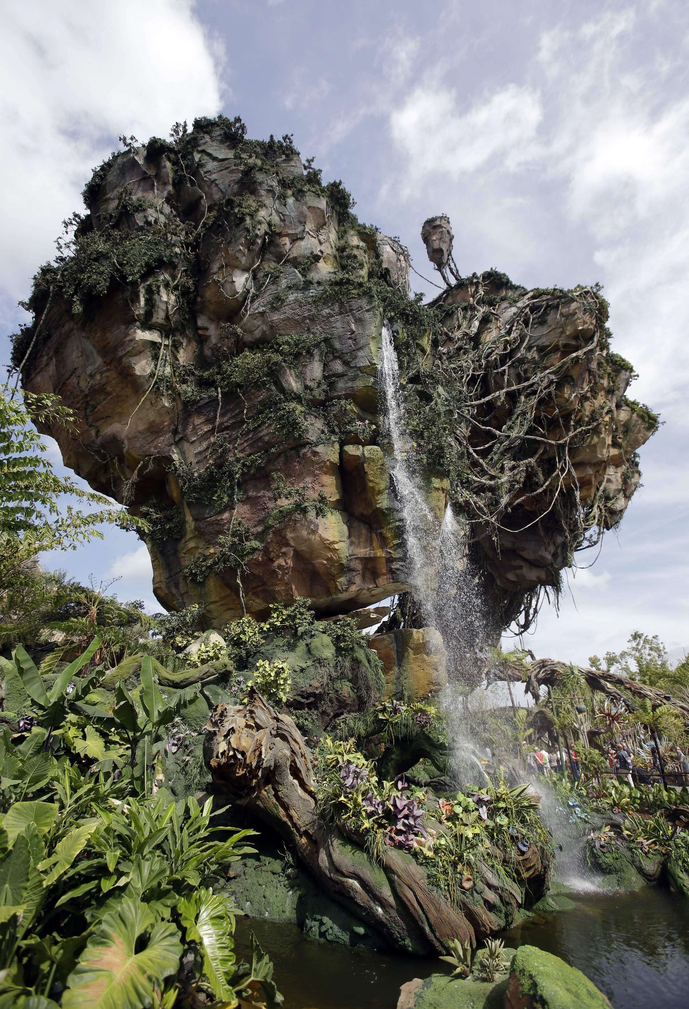 In this Saturday, April 29, 2017, photo, floating mountains are part of the scenery at Pandora-World of Avatar land attraction in Disney's Animal Kingdom theme park at Walt Disney World in Lake Buena Vista, Fla. The 12-acre land, inspired by the 'Avatar' movie, opens in Florida at the end of May at Walt Disney World's Animal Kingdom. It cost a half-billion dollars. THE ASSOCIATED PRESS