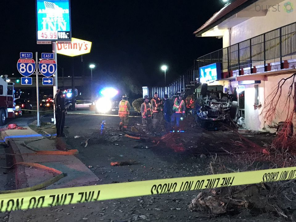 First responders are on scene of a vehicle that rolled over and crashed into a motel in Reno on Friday, Feb. 9, 2018. (KRNV/KRXI)