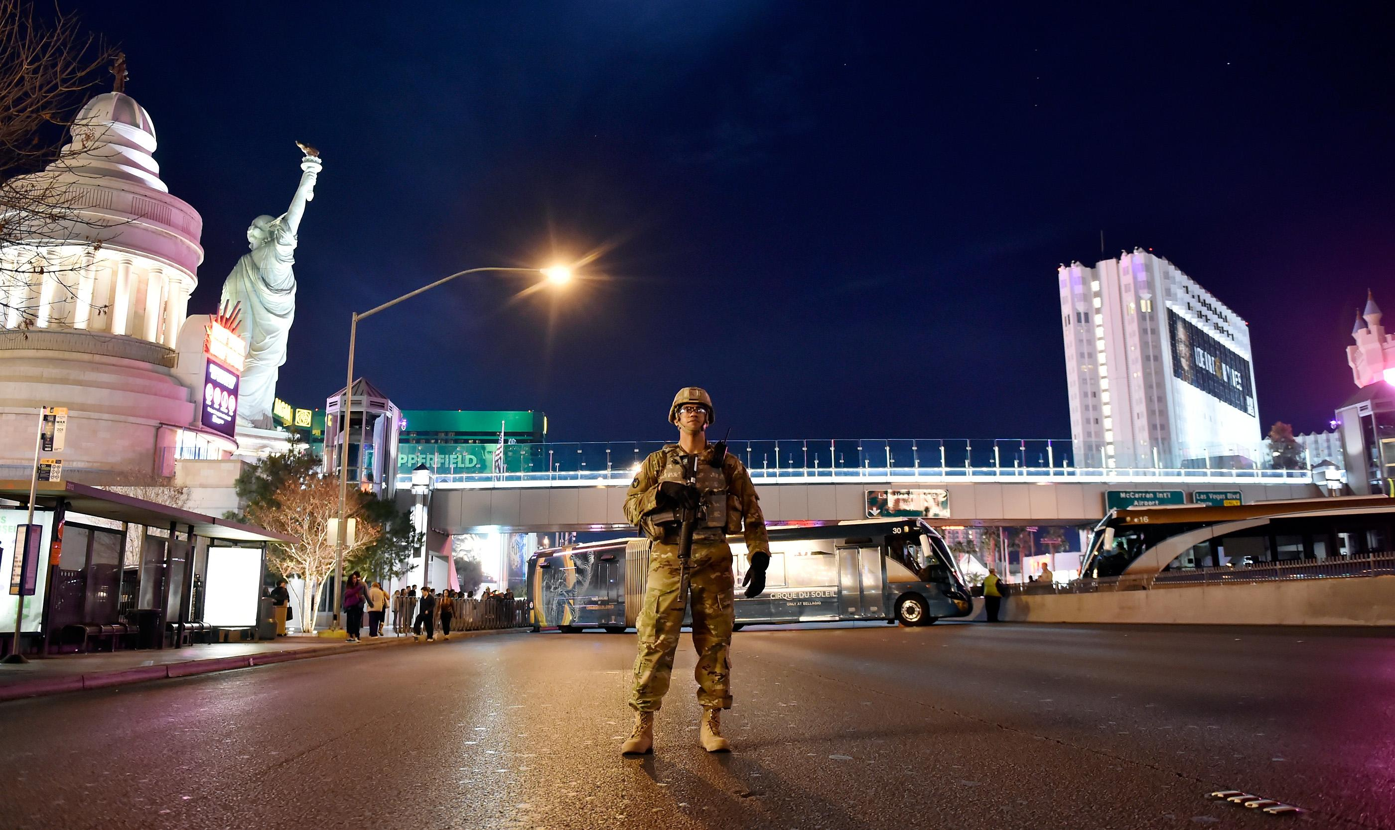 A member of the Nevada Army National Guard patrols Tropicana Boulevard during the New Year's Eve celebration along the Las Vegas Strip Sunday, Dec. 31, 2017, in Las Vegas. CREDIT: David Becker/Las Vegas News Bureau
