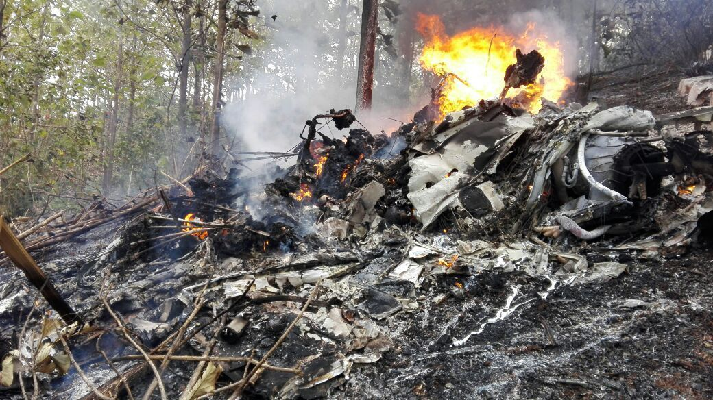 This photo released by Costa Rica's Civil Aviation press office shows the site of a plane crash in Punta Islita, Guanacaste, Costa Rica, Sunday, Dec. 31, 2017. A government statement says there were 10 foreigners and two Costa Rican crew members aboard the plane belonging to Nature Air, which had taken off nearby. (Costa Rica's Civil Aviation press office via AP)