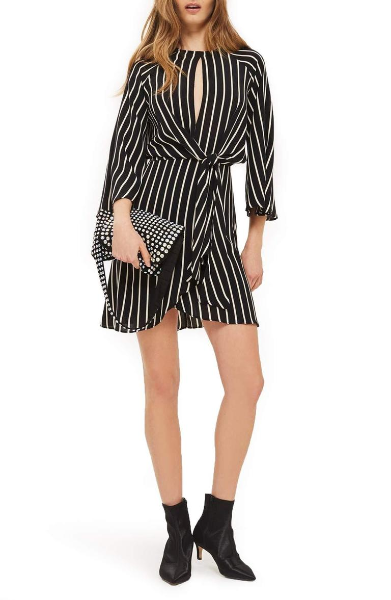 <p>More stripes please!{&amp;nbsp;} Check out this Stripe Knot Front Minidress/TOPSHOP.{&amp;nbsp;} Flowy drape and bold stripes are the design aesthetic of this raglan-sleeve dress with a tulip-style skirt and panels that gather to knot at the front waist. $90.00 at Nordstrom. (Image: Nordstrom){&amp;nbsp;}</p><p></p>