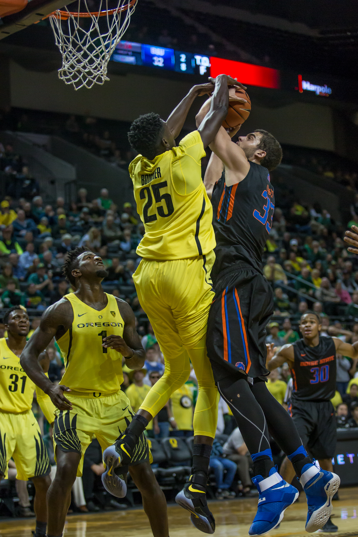 Oregon forward Chris Boucher (#25) blocks Boise State forward David Wacker's (#33) shot. After trailing for most of the game, the Oregon Ducks defeated the Boise State Broncos 68-63. Photo by Dillon Vibes