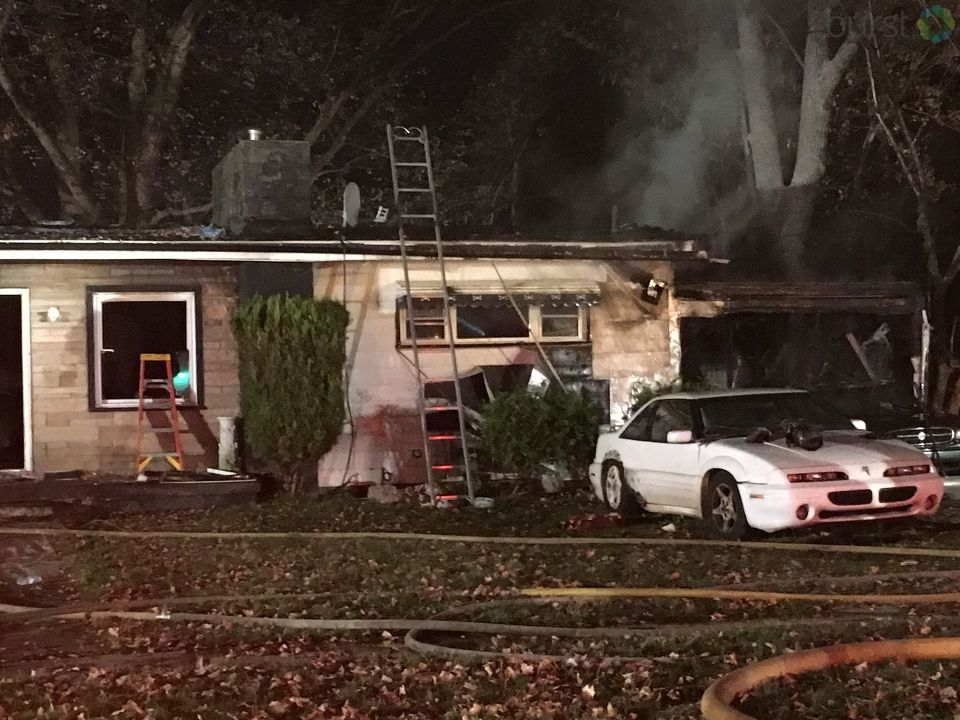 Fire damaged two Flint homes and a vehicle Tuesday night. (Photo: WEYI/WSMH)