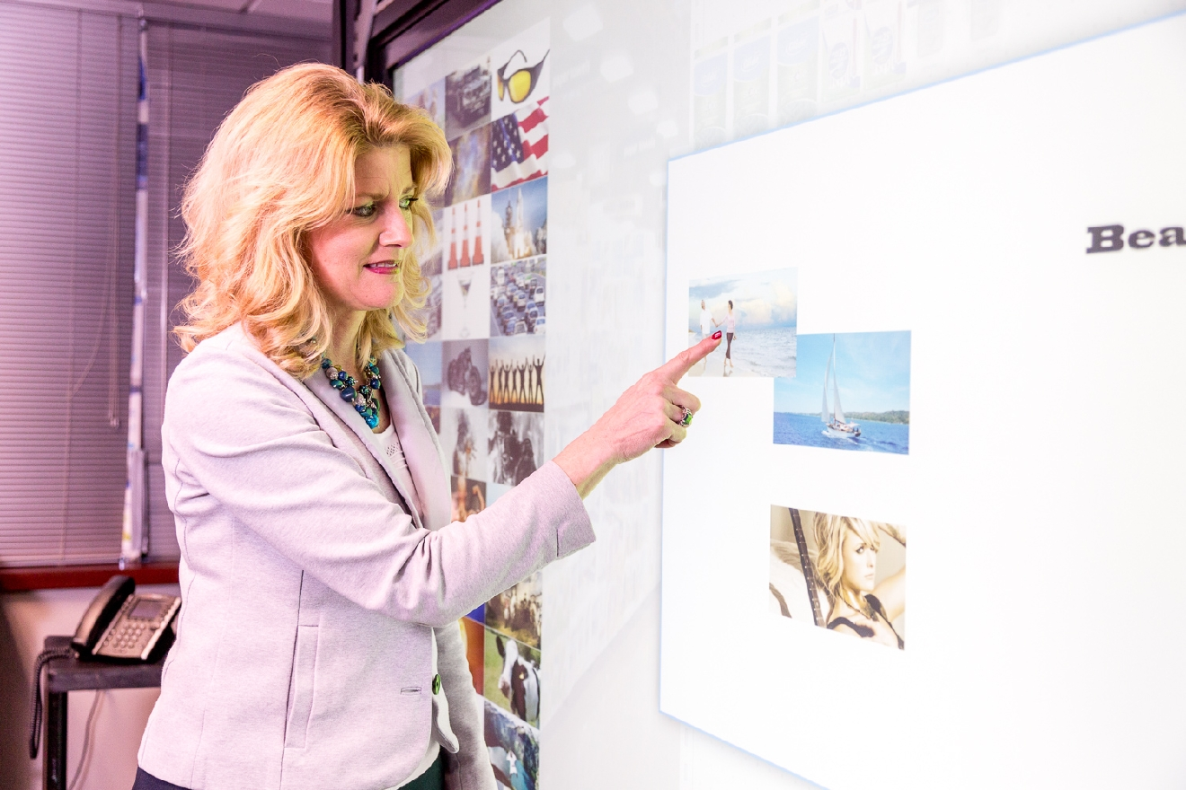 The touchscreen wall can simulate store shelves, allow focus group participants to read labels, and track their eyes as they shop. / Image: Daniel Smyth Photography