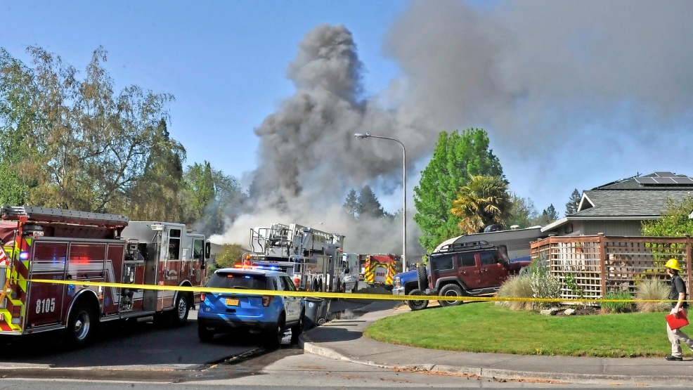 The fire spread thick, black smoke into the neighborhood that was visible from downtown Medford.