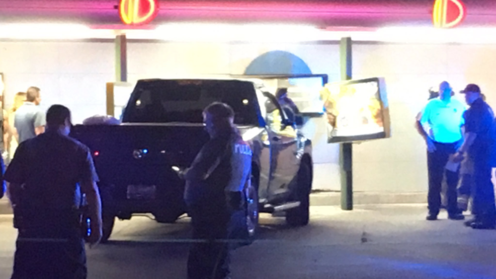 Woman crashes into Sonic Drive-In