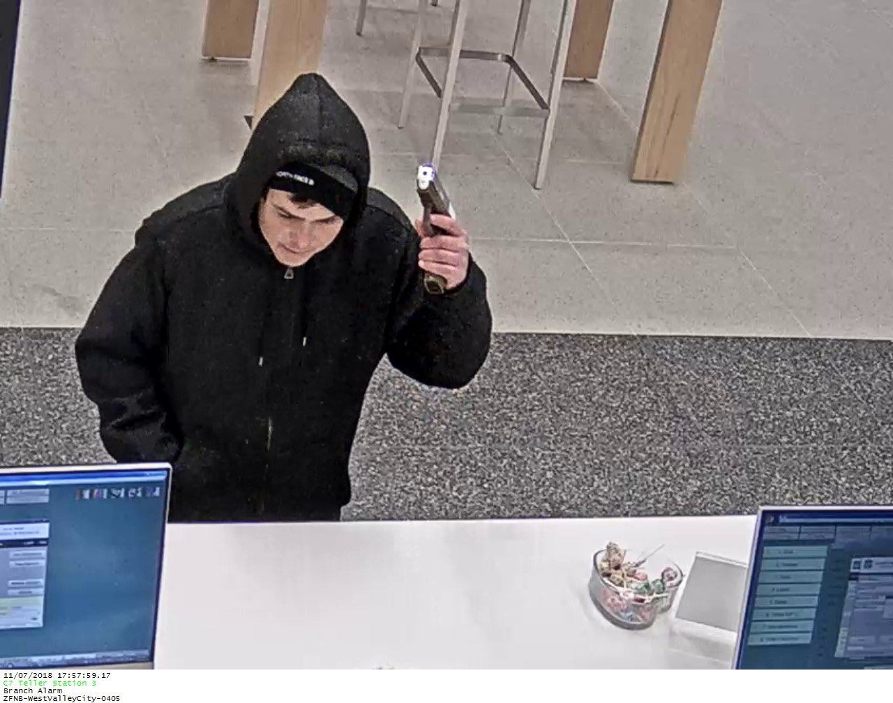 The West Valley Police Department is looking to identify a suspect who robbed a Zions Bank at gunpoint. (Photo courtesy of the West Valley Police Department)