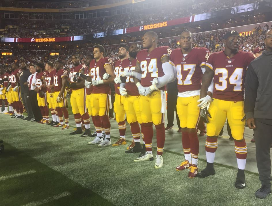 Some Washington Redskins players link arms during the National Anthem on Sunday, September 24, 2017, against the Oakland Raiders in Landover, Maryland. (Photo Courtesy of Kendall Griggs/ABC7)